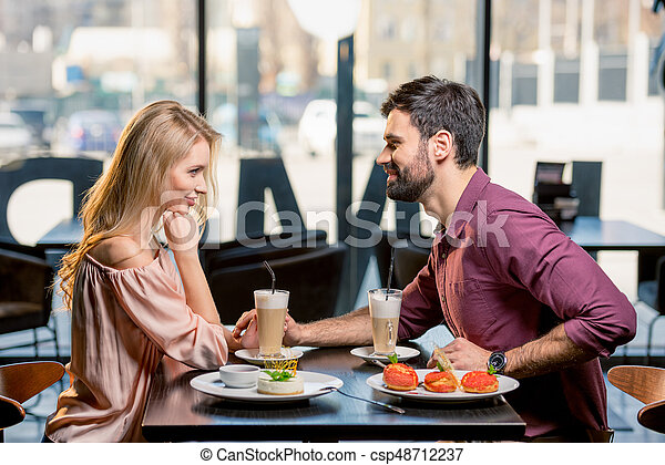 Side View Of Couple In Love Having Lunch In Restaurant Together Canstock