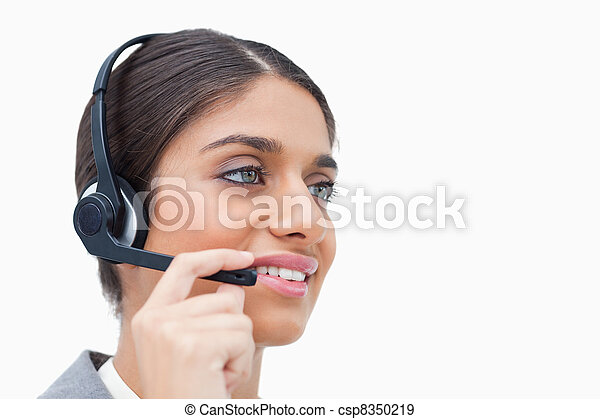 Side view of female call center agent with headset - csp8350219