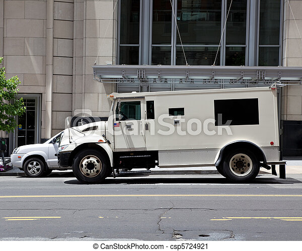 Side view of gray armored double parked on street making a cash pickup. - csp5724921