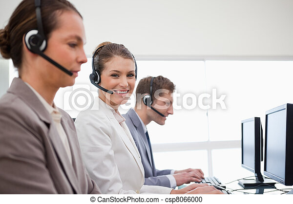 Side view of telephone service office employees - csp8066000