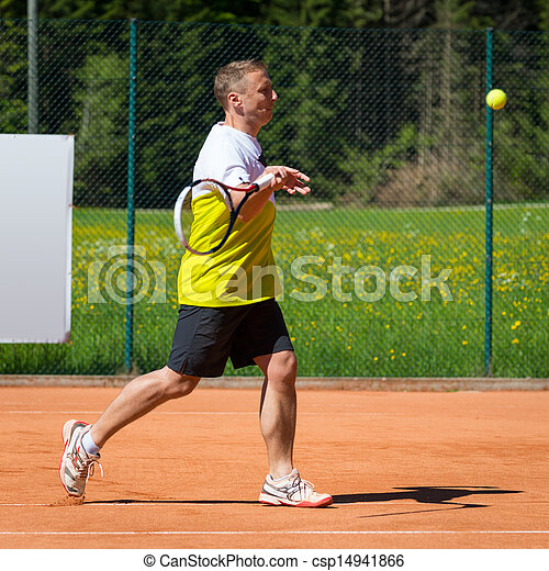 side view of tennis player hitting a forehand - csp14941866