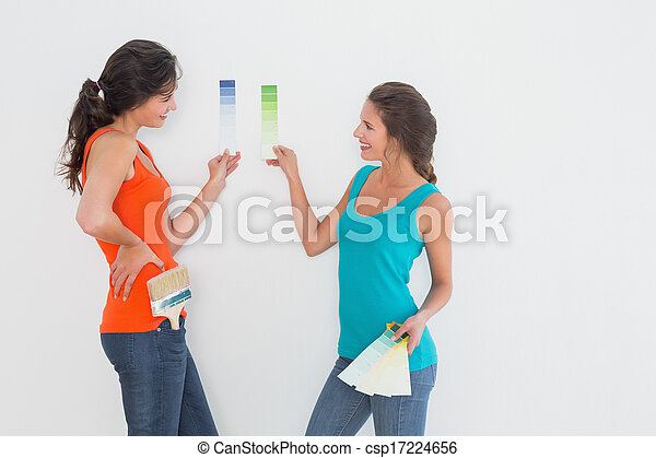 Side view of two female friends choosing color - csp17224656