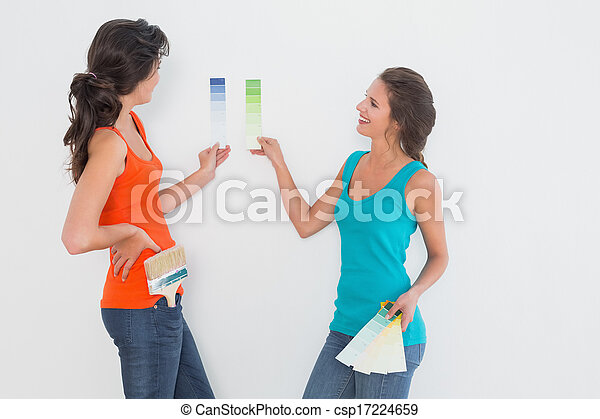 Side view of two female friends choosing color - csp17224659