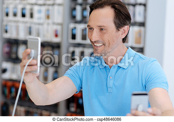 Side view on man taking self portrait with mockup phone. The quality ...