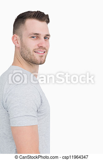 Side view portrait of smiling young man - csp11964347