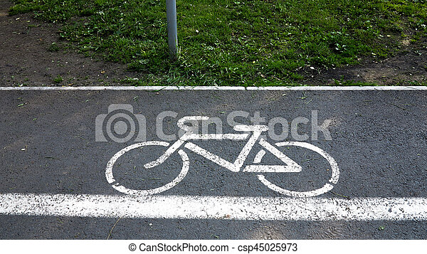 sign a cyclist on a road bike lane markings - csp45025973