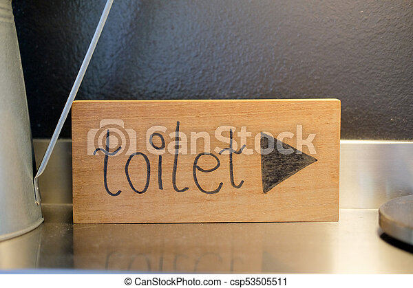 Sign of toilet written on a wooden board - csp53505511