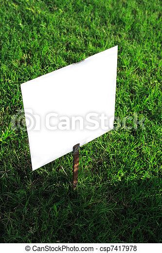 signboard on green grass - csp7417978