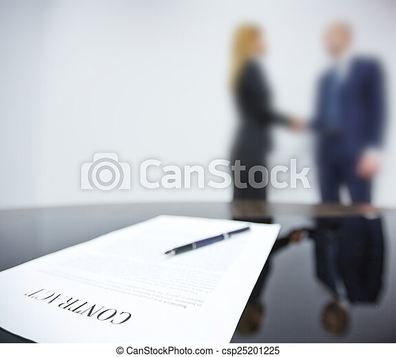 Signed Agreement Business Contract On Background Of Handshaking