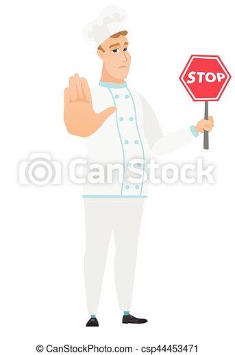 Cocinero caucásico sosteniendo señal de stop road. - csp44453471
