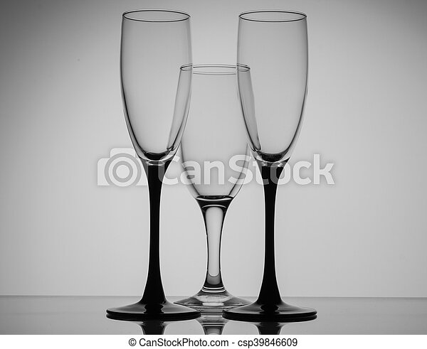 c8ef647b534 Silhouette champagne glasses black and white on grey background.