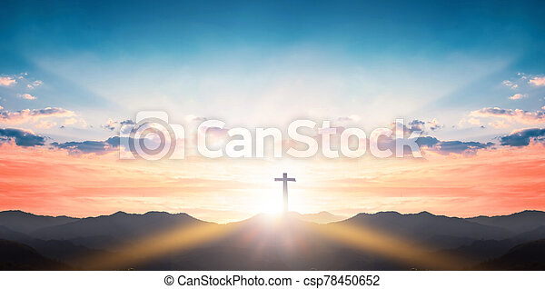 Silhouette cross on mountain sunset background - csp78450652