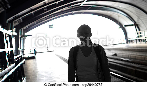 Silhouette for tourist girl backpacker waiting for train at the open station, travel abstract - csp29440767