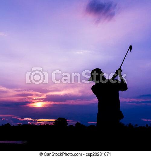 silhouette golfer at sunset - csp20231671
