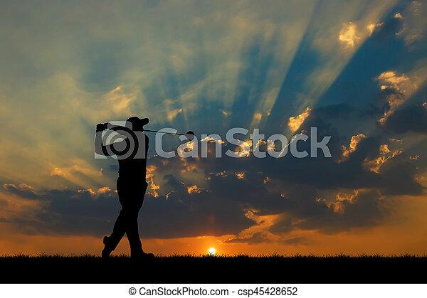 silhouette golfer playing golf during beautiful sunset - csp45428652