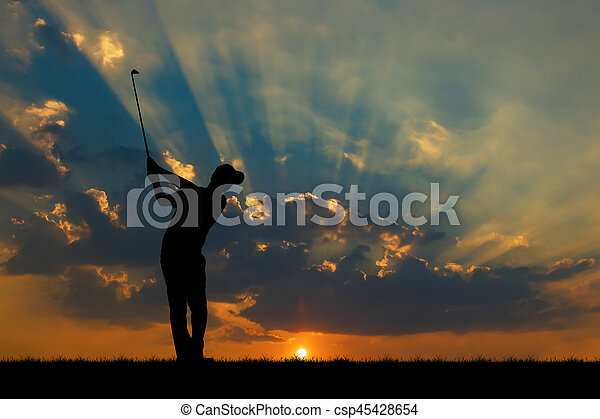 silhouette golfer playing golf during beautiful sunset - csp45428654