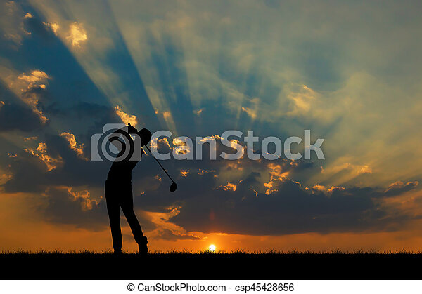 silhouette golfer playing golf during beautiful sunset - csp45428656