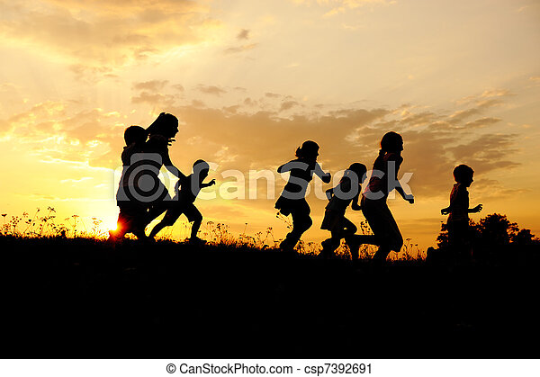 Silhouette, group of happy children playing on meadow, sunset, summertime - csp7392691