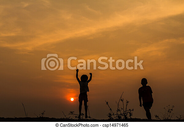 Silhouette, group of happy children playing on meadow, sunset, s - csp14971465