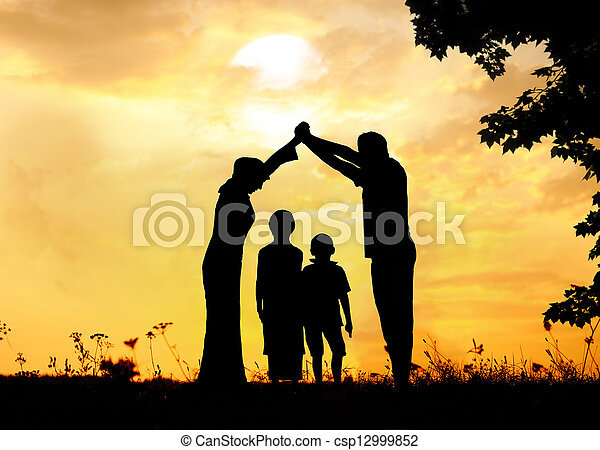 Silhouette, group of happy children playing on meadow, sunset, summertime - csp12999852