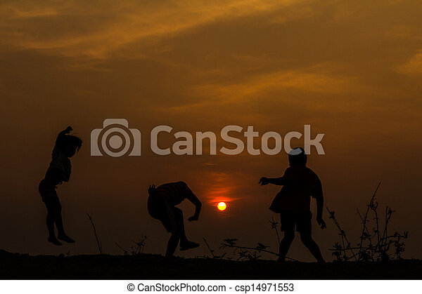 Silhouette, group of happy children playing on meadow, sunset, s - csp14971553