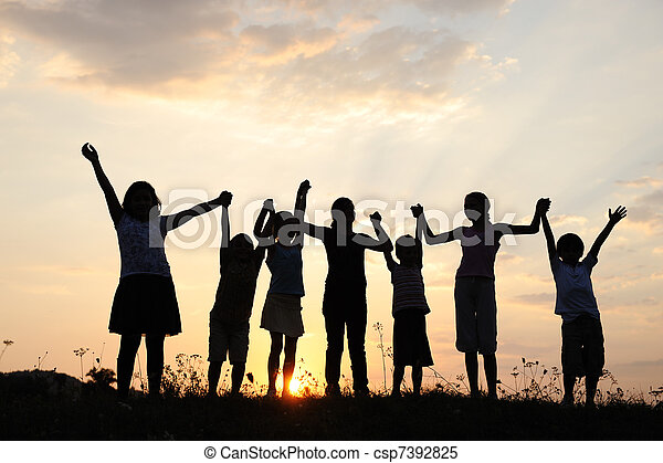 Silhouette, group of happy children playing on meadow, sunset, summertime - csp7392825