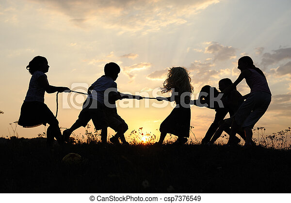 Silhouette, group of happy children playing on meadow, sunset, summertime - csp7376549