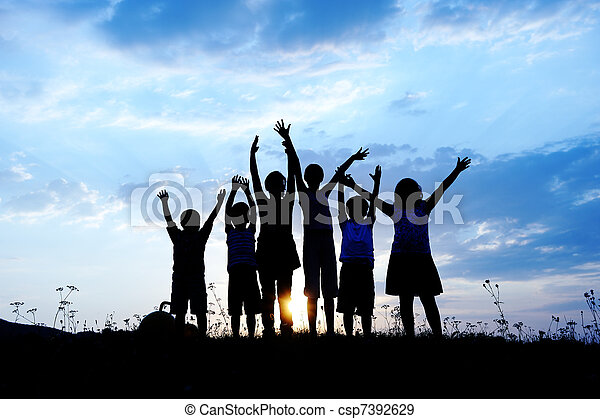 Silhouette, group of happy children playing on meadow, sunset, summertime - csp7392629
