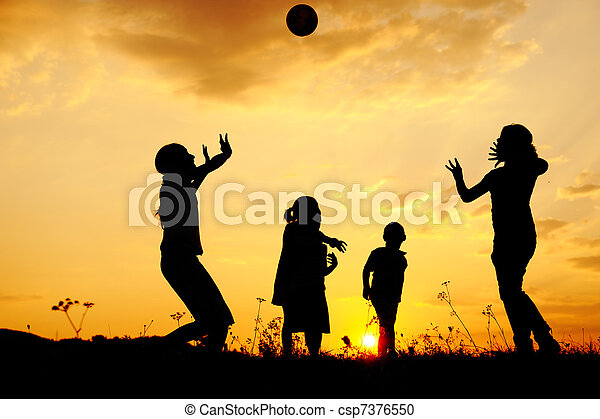 Silhouette, group of happy children playing on meadow, sunset, summertime - csp7376550