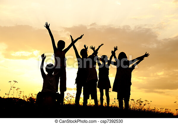 Silhouette, group of happy children playing on meadow, sunset, summertime - csp7392530