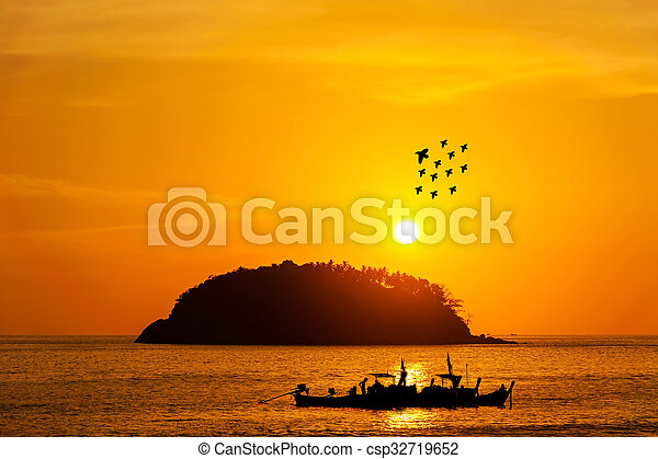 Silhouette island with fishing boat and bird in color of the sunset - csp32719652