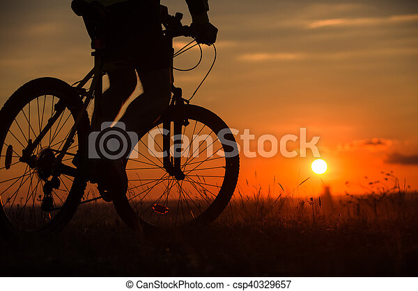 Silhouette of a bike on sky background - csp40329657