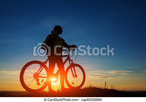 Silhouette of a bike on sky background - csp40329694