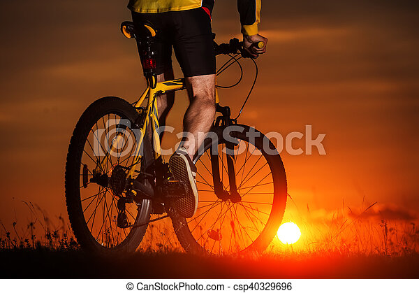 Silhouette of a bike on sky background - csp40329696