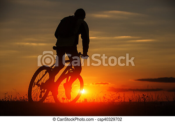 Silhouette of a bike on sky background - csp40329702