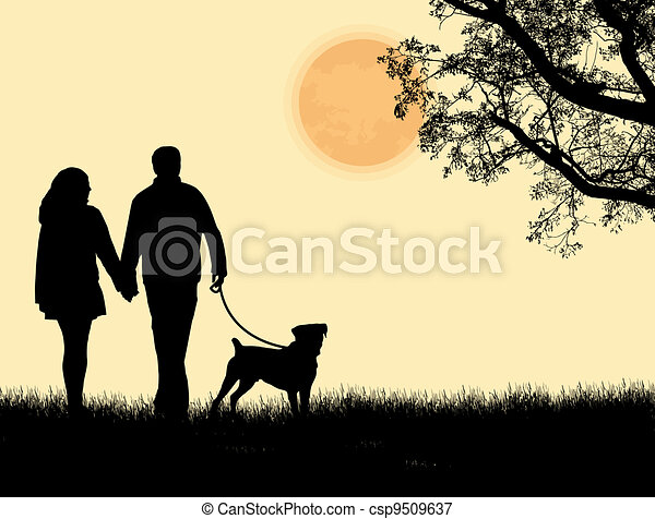Silhouette of a couple walking their dog on sunset - csp9509637