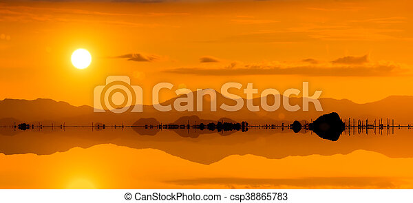 Silhouette of a mountain at the lake - csp38865783