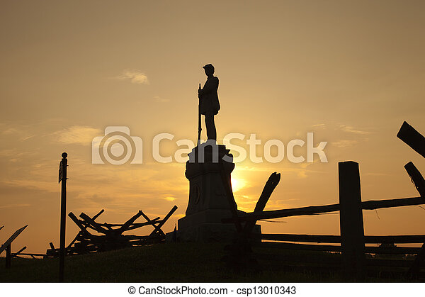 Silhouette of Civil War monument at Bloody Lane, Antietam Battlefield. This monument is in honor of the 130th Pennsylvania Volunteer infantry. - csp13010343