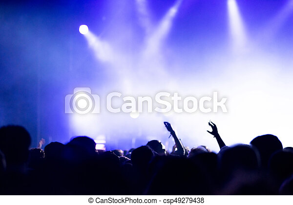 Silhouette Of Concert Crowd In Front Bright Stage Lights