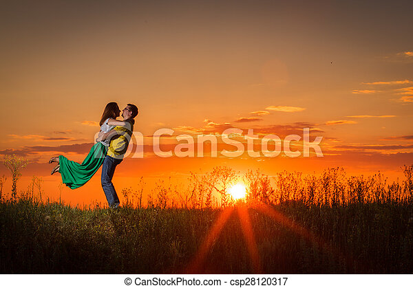 silhouette of couple at sunset - csp28120317