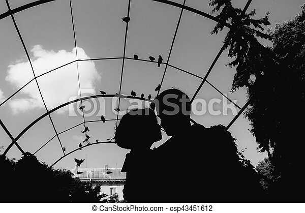 silhouette of couple on a sky background - csp43451612