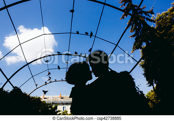 silhouette of couple on a sky background - csp42738885