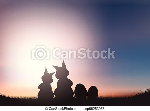 Silhouette of Easter bunnies against a sunset sky - csp66253956