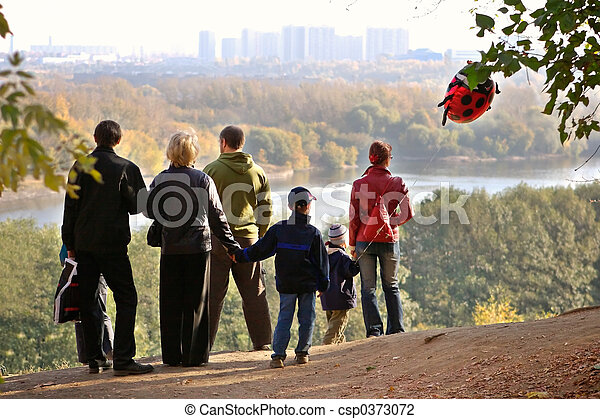 Silhouette of family admiring an autumn decline - csp0373072