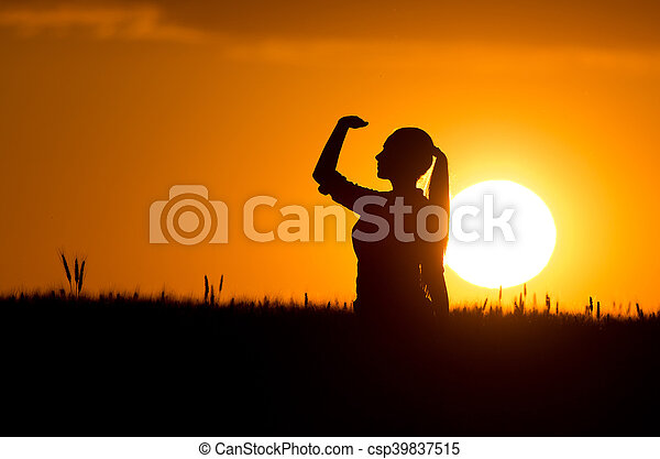 Silhouette of girl in wheat field - csp39837515