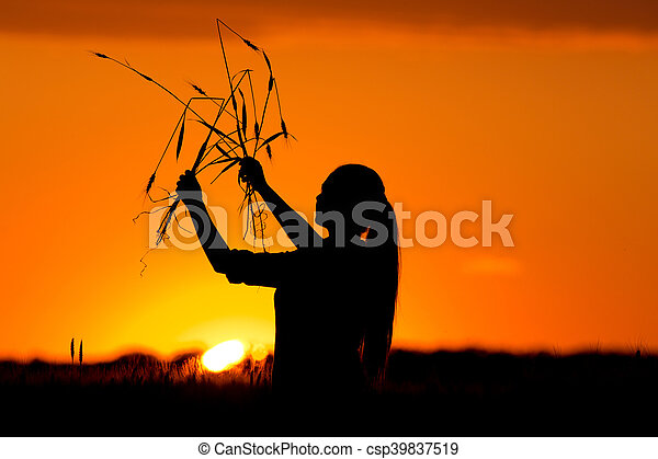 Silhouette of girl in wheat field - csp39837519