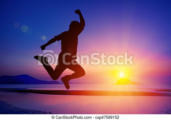 Silhouette of happy people jumping in sunset. with flare on the beach at Sattahip, Thailand - csp47599152