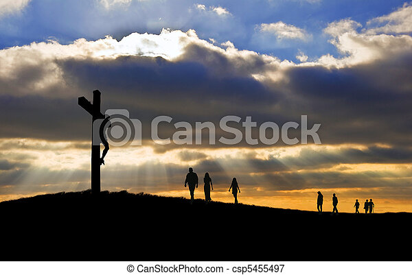 Silhouette of Jesus Christ crucifixion on cross on Good Friday Easter witth people walking up hill towards Jesus - csp5455497