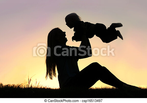 Silhouette of Laughing Mother and Baby Playing Outside - csp16513497