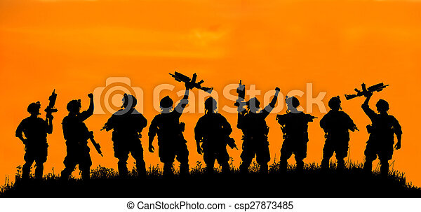 Silhouette of military soldier or officer with weapons at sunset. - csp27873485